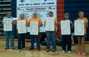 'Doah photo by Liz Levey Pictured is the reveal of how much money was raised at the car show. From left to right: Harold Ruckman (Treasurer of Hoppers Auto Club), Marie Clary (Co-Chair of Relay For Life and Cars for a Cause), Danny Boyce, Shelby DeHaven (Co-Chair of Cars for a Cause), Debbie Boyce, Katie Motsko (Co-Chairs of Relay For Life) and Ted Morgan (President of Hoppers Auto Club).